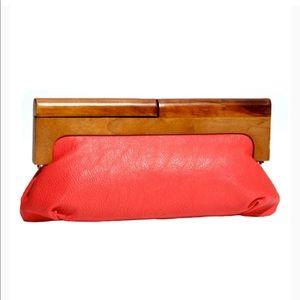 EUC-Melie Bianco orange clutch w/wood handle.